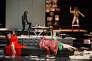 """De gauche à droite : Judith Henry en robe rouge, Stanislas Nordey en cuir, Thomas Gonzalez, nu et Laurent Sauvage, allongé dans """"Je suis Fassbinder"""" au Théâtre national de Strasbourg (TNS)."""