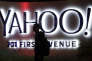 FILE - In this Nov. 5, 2014, file photo, a person walks in front of a Yahoo sign at the company's headquarters in Sunnyvale, Calif. Yahoo announced Wednesday, March 2, 2016, that the company is adding a new component to its Sports vertical: competitive video gaming. Yahoo said that Esports will offer video coverage of live tournaments, including expert commentary and interviews with top players. Esports will also include articles, scores, team rosters, schedules, player rankings, calendars and statistics. (AP Photo/Marcio Jose Sanchez, File)