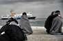 Des migrants à leur arrivée en Grèce au port de Mytilène sur l'île de Lesbos le 2 mars 2016.