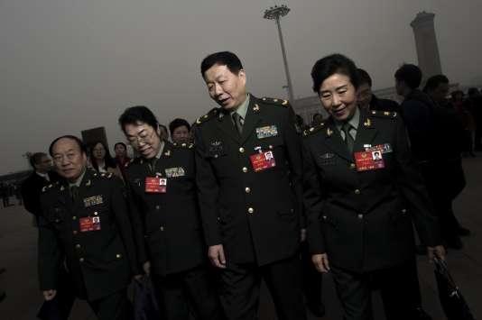 Des délégués arrivent jeudi 3 mars au Palais du peuple de Pékin pour la Conférence consultative du peuple chinois (CCPC).