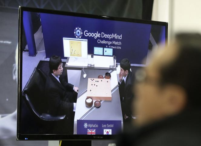 A man watches a TV screen showing the live broadcast of the Google DeepMind Challenge Match at Korea Baduk Association office in Seoul, South Korea, Wednesday, March 9, 2016. Computers eventually will defeat human players of Go, but the beauty of the ancient Chinese game of strategy that has fascinated people for thousands of years will remain, Go world champion Lee Sedol, right, said Tuesday. (AP Photo/Ahn Young-joon)