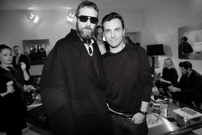 Les créateurs Stefano Pilati et Nicolas Ghesquière lors du premier show de Nicolas Ghesquière pour Louis Vuitton le 5 mars 2014.