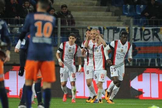 Les Niçois après le but de Valère Germain, samedi 12 mars, à Montpellier.