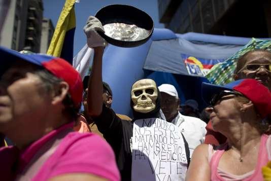 Lors d'une manifestation contre Maduro à Caracas au Venezuela le 12 mars 2016.