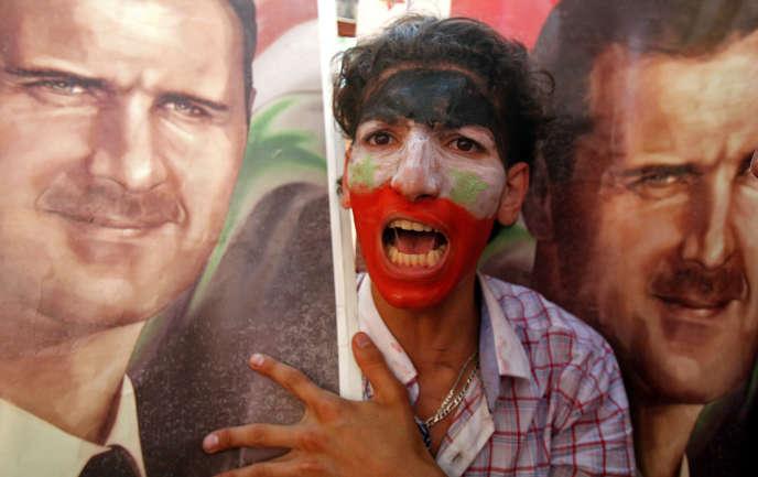 Lors d'une manifestation en soutien à Bachar Al-Assad, à Beyrouth, le 24 juin.