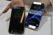"""FILE - In this Sunday, Feb. 21, 2016, file photo, a Samsung Galaxy S7, left, and S7 Edge are displayed during the Samsung Galaxy Unpacked 2016 event on the eve of the Mobile World Congress wireless show, in Barcelona, Spain. In a study released Monday, March 14, 2016, SquareTrade, a company that offers extended-protection plans for gadgets, said the Galaxy S7 and S7 Edge still functioned after being submerged in water for 30 minutes. Audio was """"permanently muffled and distorted"""" after the dunking, but the Samsung phones still outlasted Apple's iPhones in SquareTrade's water tests. (AP Photo/Manu Fernandez, File)"""
