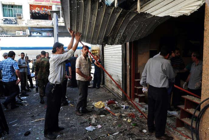 Dans une rue de Damas, après une explosion, en juin 2013.