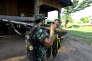 Soldats de l'Armée démocratique bouddhiste karen (DKBA), dans leur camp de Kawthumweke, en mai 2012.