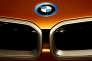 The logo of the German car manufacturer BMW is photographed on a BMWi Vision Future Interaction concept car during the full-year earnings press conference in Munich, Germany, Wednesday, March 16, 2016. (AP Photo/Matthias Schrader)