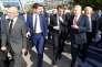 Emmanuel Macron, au centre, inaugure le Marché international de l'immobilier, à Cannes, mardi.