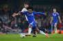 Le milieu de terrain de Chelsea Willian contre le PSG en huitièmes de finale de la Ligue des champions le 9 mars à Londres.