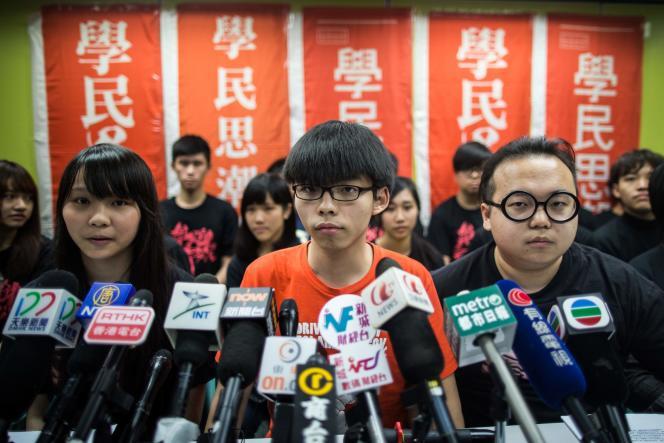 Joshua Wong, au centre, à Hongkong, le 20 mars 2016.