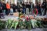 Devant la Bourse de Bruxelles, en commémoration aux victimes des attentats, le 22 mars 2016.