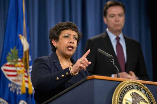 La ministre américaine de la justice Loretta Lynch, et le directeur du FBI, James Comey, jeudi 24 mars.