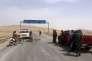 Une photo de l'agence officielle d'information syrienne SANA montre des soldats du gouvernement à l'entrée de la ville de Palmyre, au centre de la Syrie, jeudi 24 mars.