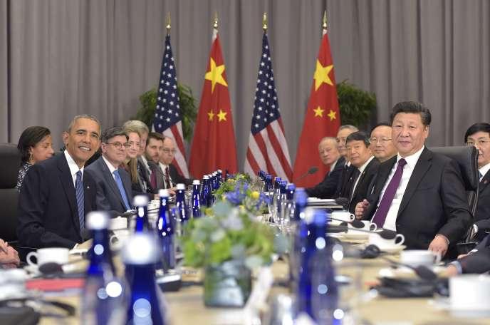Barack Obama et Xi Jinping lors d'une rencontre bilatérale en marge du sommet sur la sûreté nucléaire à Washington le 31 mars 2016.