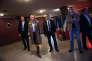 Meeting de lancement de la campagne des municipales du Front National à Paris, le 17 novembre 2013. La Présidente du FN, Marine Le Pen quitte les coulisses pour rejoindre la scène, en présence d'Axel Loustau (à droite) et Frédéric Chatillon (le 2nd à droite).