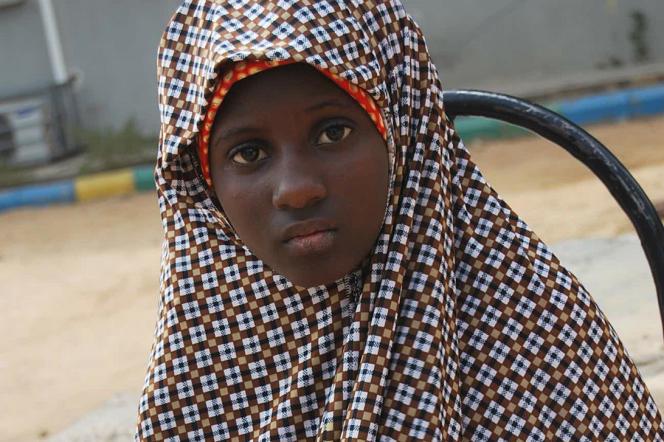 Une jeune Nigériane de 13 ans. Elle a été trouvée avec des explosifs attachés à son corps et sauvée in extremis de la mort, le 24 décembre 2014 à Kano, au Nigeria.