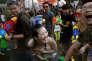 """Lors de la """"fête de l'eau"""" du Festival Songkran, à Bangkok, le 13 avril."""