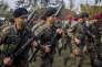 Les forces spéciales de l'armée salvadorienne participent à un exercice devant la presse, dans le cadre du projet gouvernemental de renforcement de la lutte contre les maras, à San Salvador, mercredi 20 avril.