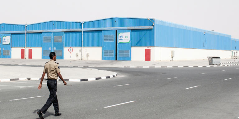Dubai, United Arab Emirates - 14 May 2014. Security guards on patrol at the warehouses of International Humanitarian City (IHC). This is a logistical hub for humanitarian aid with nine UN agencies and nearly 50 NGOs and commercial entities as members.