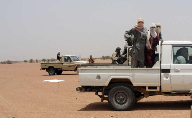 Des combattants du groupe islamiste Ansar Dine à Kidal, dans le nord-est du Mali, en2012.