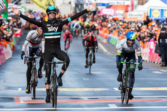 Wouter Poels of Team Sky celebrates as he crosses the finish line to win the Liege-Bastogne-Liege cycling classic in Ans, Belgium on Sunday April 24, 2016. Michael Albasini of the Orica Greenedge team placed second and Rui Costa of the Lampre Merida team finished third. (AP Photo/Geert Vanden Wijngaert)