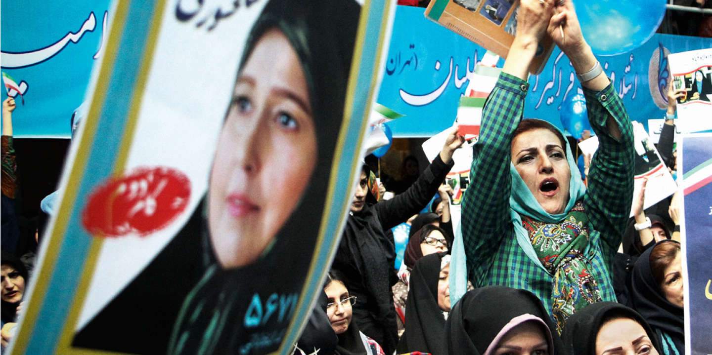 (160221) -- TEHRAN, Feb. 21, 2016 (Xinhua) -- Iranian women hold up posters during a reformists campaign meeting in Tehran, capital of Iran, on Feb. 20, 2016. Iranian hopefuls began their campaigns on Thursday in a run for two important Majlis (parliament) and Assembly of Experts' elections slated for Feb. 26.   (Xinhua/Ahmad Halabisaz)