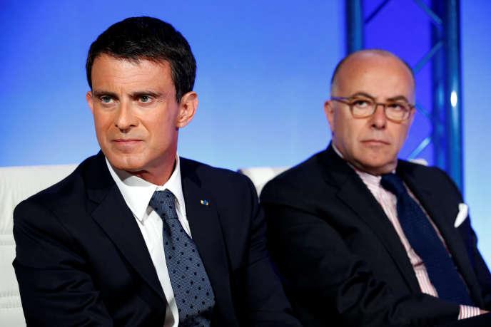 Le premier ministre, Manuel Valls, et le ministre de l'intérieur, Bernard Cazeneuve, le 9 mai à Matignon.