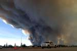 """TOPSHOT - In this image released by the Alberta Royal Canadian Mounted Police (RCMP), members of the RCMP monitor the Fort McMurray Wildfire, on May 7, 2016 in Fort McMurray, Canada. The ferocious wildfire wreaking havoc in Canada doubled in size and officials warned that the situation in the parched Alberta oil sands region was """"unpredictable and dangerous."""" """"This remains a big, out of control, dangerous fire,"""" Public Safety Minister Ralph Goodale said of the raging inferno bigger than London that forced the evacuation of the city of Fort McMurray. Winds were pushing the flames east of the epicenter around the oil city late Saturday, as nearly all 25,000 people who were still trapped to the north finally left town, either via airlift or convoys on the roads. The wildfire had doubled in size in one day, covering more than 200,000 hectares (494,000 acres) by midnight and continuing to grow, the Alberta Emergency Management Agency said in an update late May 6.  - RESTRICTED TO EDITORIAL USE - MANDATORY CREDIT """"AFP PHOTO / ALBERTA RCMP/ HO"""" - NO MARKETING NO ADVERTISING CAMPAIGNS - DISTRIBUTED AS A SERVICE TO CLIENTS    / AFP / Alberta RCMP / RCMP Alberta / RESTRICTED TO EDITORIAL USE - MANDATORY CREDIT """"AFP PHOTO / ALBERTA RCMP/ HO"""" - NO MARKETING NO ADVERTISING CAMPAIGNS - DISTRIBUTED AS A SERVICE TO CLIENTS"""