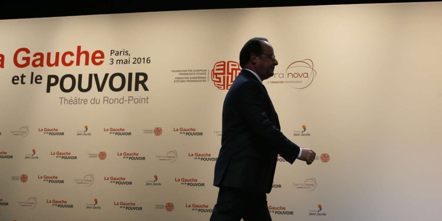 French President Francois Hollande leaves the stage after delivering a speech during the conference