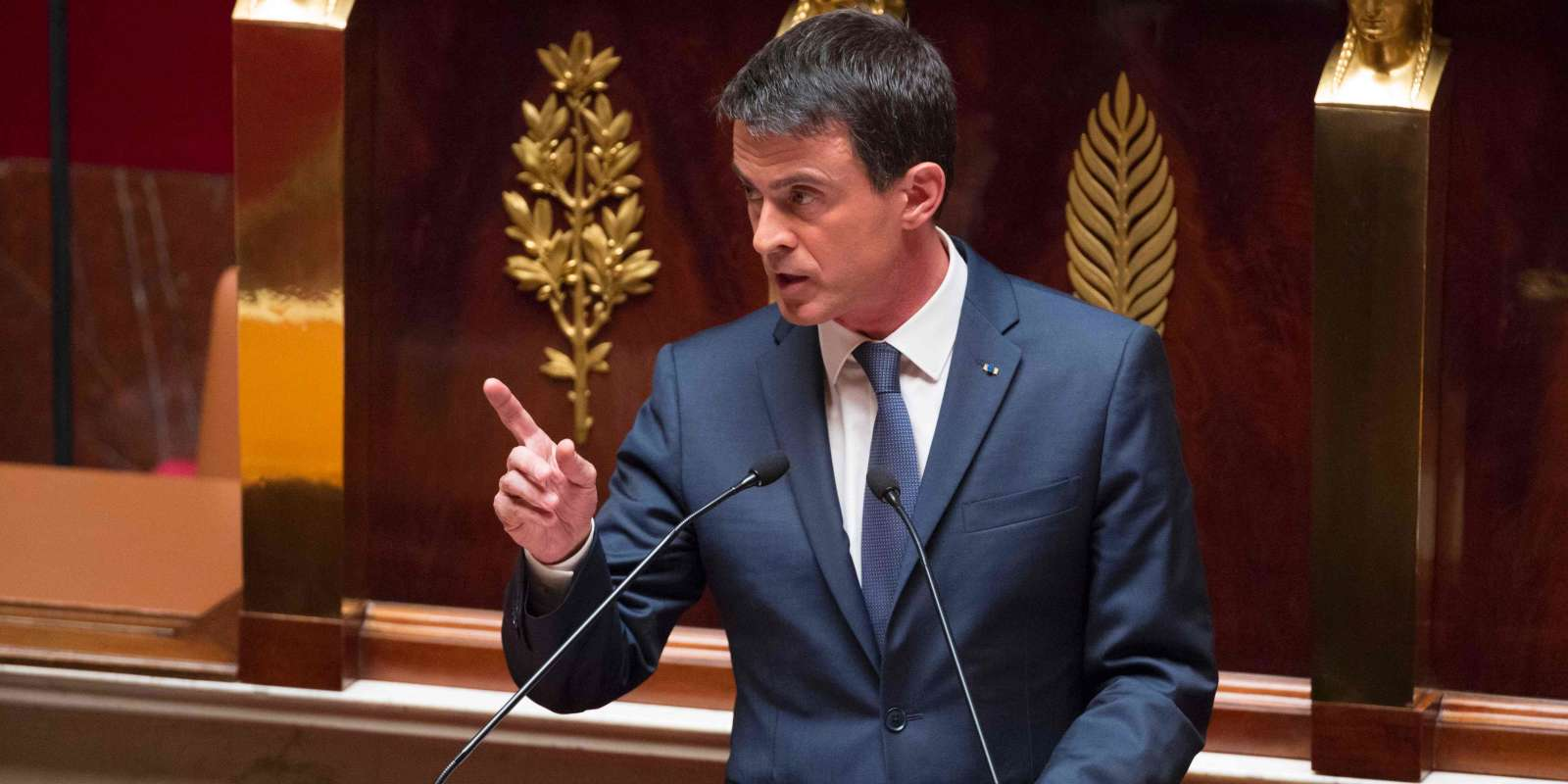 French Prime minister Manuel Valls gives a speech during a debate following by a no-confidence vote, on May 12, 2016 at the National Assembly in Paris. France's embattled Socialist government faces a no-confidence vote on May 12 after bypassing parliament to force through a labour reform bill that has drawn hundreds of thousands onto the streets over the last two months. The proposed labour reform, which would make it easier for employers to hire and fire workers, has sparked waves of sometimes violent protests across France since early March. Hollande's cabinet decided at an extraordinary meeting on May 10, 2016 to invoke the constitution's controversial Article 49.3. / AFP / GEOFFROY VAN DER HASSELT