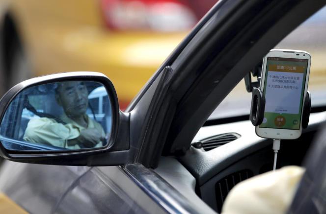 Un taxi chinois utilisant l'application Didi Chuxing, à Pékin, en septembre 2015.