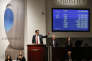 """Auctioneer Andreas Rumbler takes bids on Monet's """"Water Lilys,"""" during Christie's Impressionist and Modern Art spring sale Thursday, May 12, 2016, in New York. A Frida Kahlo painting broke the world auction record for the artist, but also for any Latin American artist sold at auction. (AP Photo/Kathy Willens)"""