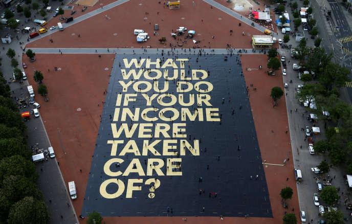 Pancarte à Genève, le 14 mai 2016 : « Que feriez-vous si votre salaire était assuré ?»