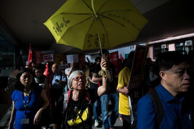 Protestation dans les rues de Honkong, à l'occasion de la deuxième journée de visite du numéro 3 chinois, Zhang Dejiang, président de l'Assemblée nationale populaire et chargé des affaires hongkongaises.
