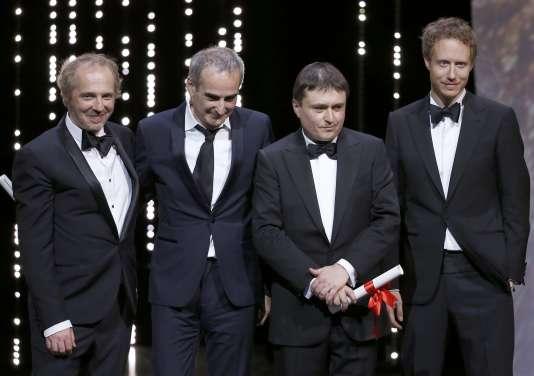 Au centre, Olivier Assayas et Cristian Mungiu (à droite) entourés des membres du jury, Arnaud Desplechin (à gauche) etLaszlo Nemes.