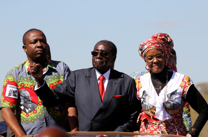 Zimbabwe's President Robert Mugabe and his wife Grace greet supporters of his ZANU (PF) party during the