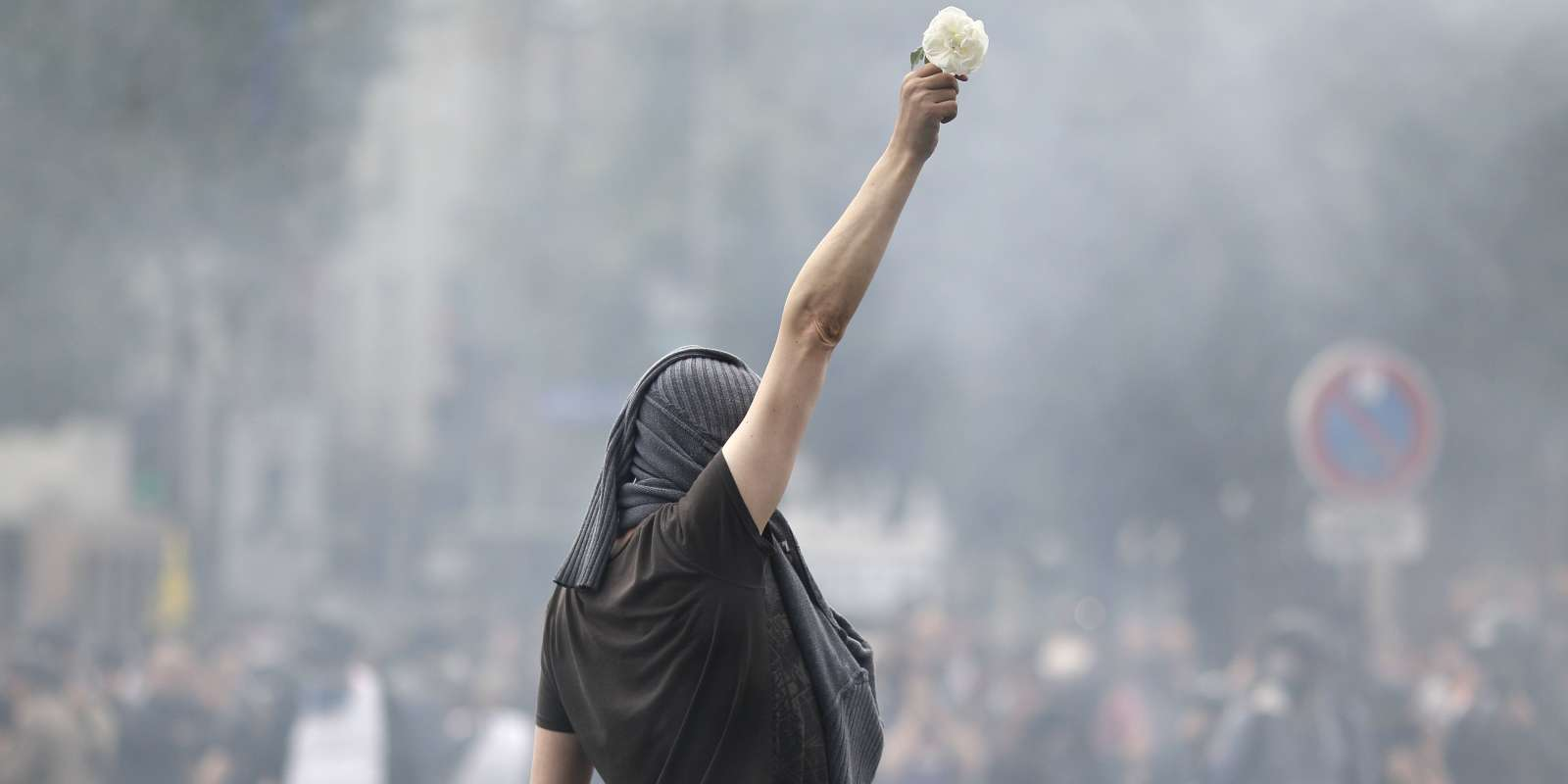 A protester holds a white rose during a protest against the government's labour market reforms in Paris, on May 26, 2016. The French government's labour market proposals, which are designed to make it easier for companies to hire and fire, have sparked a series of nationwide protests and strikes over the past three months.