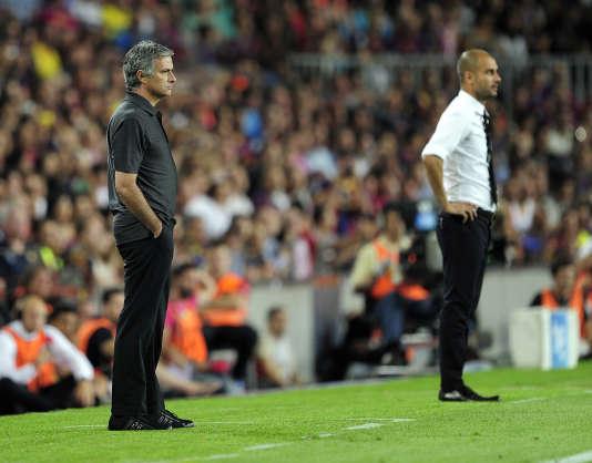 José Mourinho et Josep Guardiola, en 2011 au Camp Nou, à Barcelone.