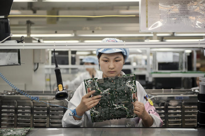 Ligne d'assemblage Hewlett-Packard dans une usine Foxconn, à Congqinq, en Chine, en 2012.