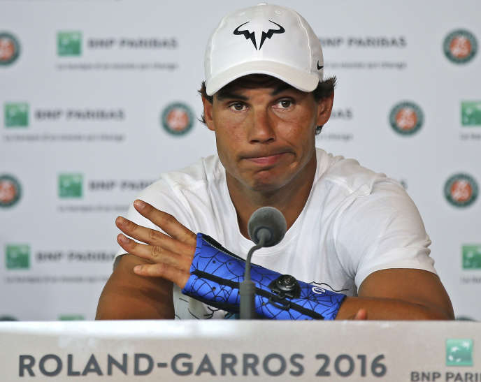 FILE - In thi Friay May 27, 2016 file photo, nine-time champion Rafael Nadal, of Spain, announces he is pulling out of the French Open because of an injury to his left wrist at the Roland Garros stadium in Paris, France. Nadal has pulled out of the Queen's Club grass-court tournament that serves as a tuneup for Wimbledon, citing the left wrist injury that cut his French Open short. (AP Photo/Michel Euler)