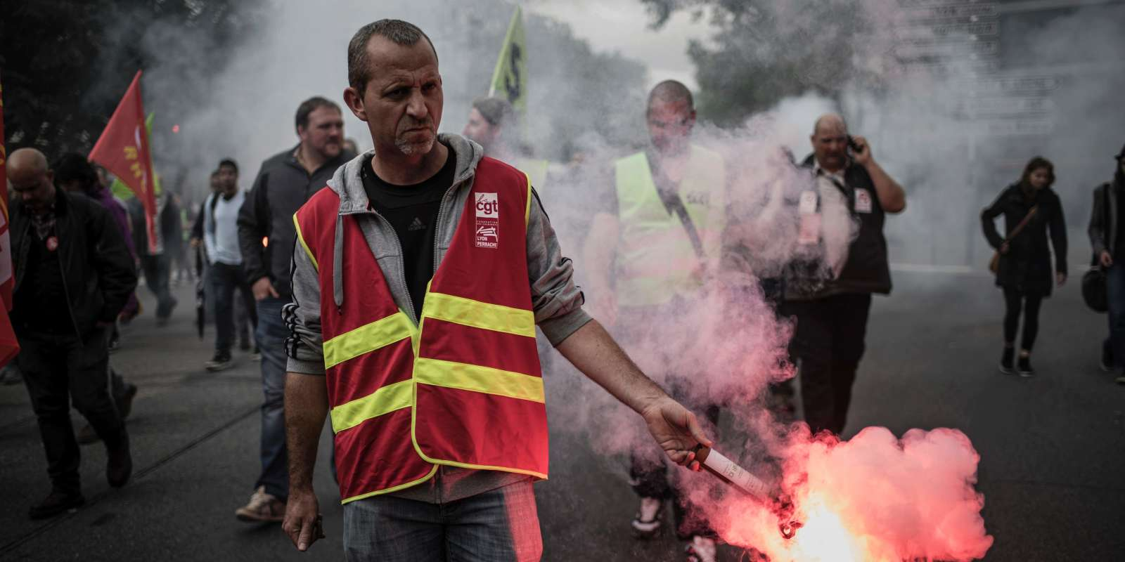 Striking employees of the French state-owned rail operator SNCF demonstrate in front of the MEDEF's (French employers' association) branch in Lyon on June 1, 2016 during a strike to protest against government labour reforms. Transport chaos hit France on June 1, just nine days before the Euro 2016 football tournament, as railway workers went on strike in the latest salvo of a months-long battle between the government and unions. / AFP / JEFF PACHOUD