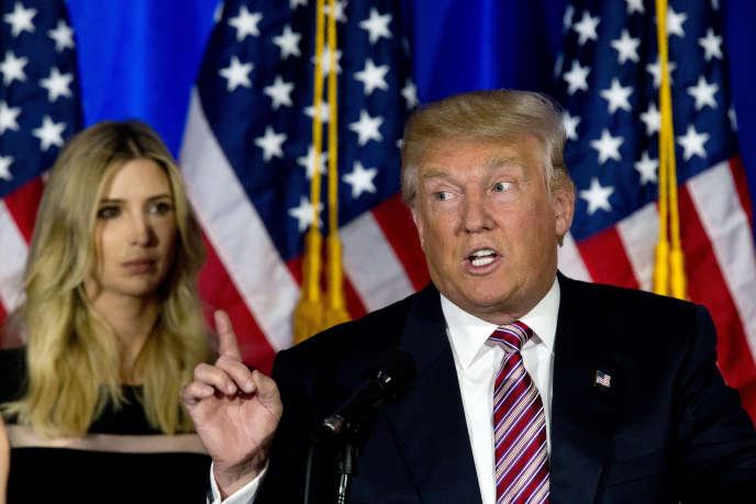 Le futur candidat républicain, Donald Trump, avec sa fille Ivanka,lors d'une conférence de presse au Trump National Golf Club Westchester dans l'Etat de New York, mardi 7 juin 2016.