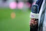 A reporter of Qatar's Al-Jazeera owned television channel BeIN Sports is seen holding his microphone with the channel's logo, prior to the French L1 football match between Nantes and Bordeaux on March 29, 2014 at the Beaujoire stadium in Nantes, western France. AFP PHOTO / JEAN-SEBASTIEN EVRARD / AFP PHOTO / JEAN-SEBASTIEN EVRARD