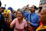 A woman shows a flour package outside a supermarket as they shout slogans over food shortage in Caracas, Venezuela, June 11, 2016. REUTERS/Ivan Alvarado/File Photo