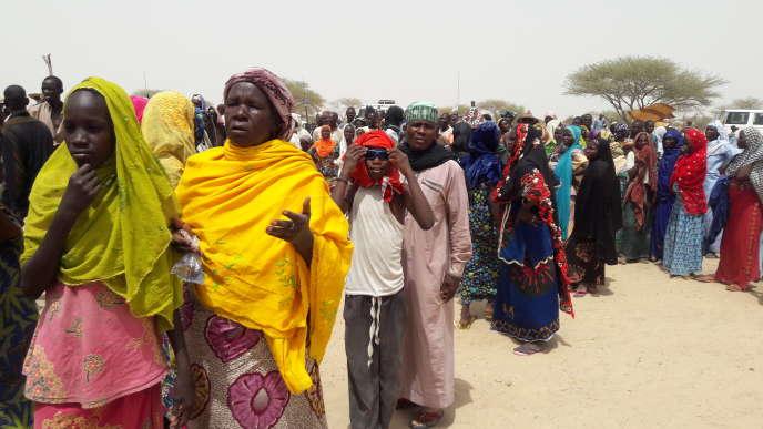 Des réfugiés en attente de distribution d'aide humanitaire,vendredi 10 juin, au camp de Kijendi, qui comptait déjà 12 000 réfugiés avant les récentes attaques et s'est considérablement peuplé depuis.