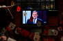 Spanish acting Prime Minister and People's Party (PP) leader Mariano Rajoy is seen on a television screen at a restaurant during a live televised debate in Madrid, Spain, June 13, 2016. REUTERS/Susana Vera