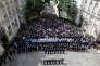 Au ministère de l'intérieur à Paris, le 15 juin, le président de la République et le gouvernement lors de la cérémonie en l'honneur des deux fonctionnaires de police tués lundi parLarossi Abballa.