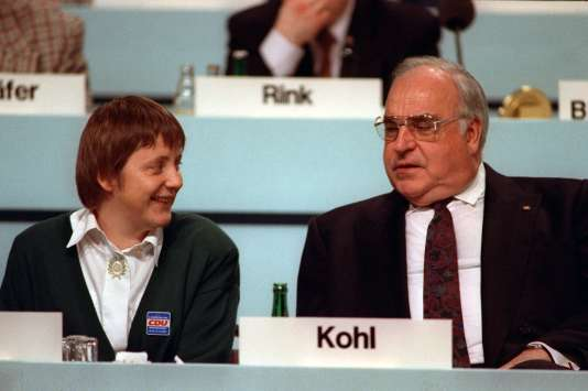 German chancellor Helmut Kohl and his newly elected representative, Minister for Women Angela Merkel, during the party conference of the CDU on the 16th of December in 1991 in Dresden.